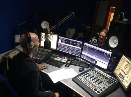 Paul & Nessa in the radio studio, broadcasting Happy Hour